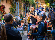 Street musicians entertain the crowds enjoying the outdoor cafes, on the steps surrounding the Acropolis in Athens, Greece.<br /> <br /> Travelling through Greece, first stop Athens
