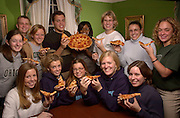 15657Student Alumni Board Members holding slice of Pizza for Ohio Today Ad
