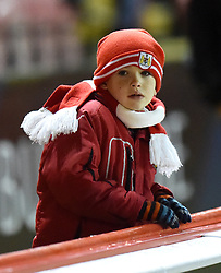 A young supporter at Ashton Gate for Bristol City's Johnstone's Paint Trophy tie against Coventry City - Photo mandatory by-line: Paul Knight/JMP - Mobile: 07966 386802 - 10/12/2014 - SPORT - Football - Bristol - Ashton Gate Stadium - Bristol City v Coventry City - Johnstone's Paint Trophy