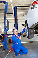 Man working on car tire