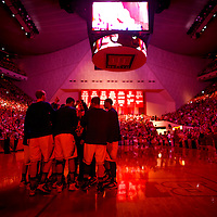 BLOOMINGTON, IN -- February 3, 2013 -- The University of Michigan basketball team huddles up in a red-covered Assembly Hall before taking on the Indiana University Hoosiers.  (PHOTO / CHIP LITHERLAND)