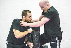 Students practising their kicking punches. Stef Noij, KMG Instructor from the Institute Krav Maga Netherlands, takes the IKMS G Level Programme seminar today at the Scottish Martial Arts Centre, Alloa.