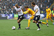 Bolton Midfielder Darren Pratley challenged by Preston North End Midfielder Adam Reachduring the Sky Bet Championship match between Bolton Wanderers and Preston North End at the Macron Stadium, Bolton, England on 12 March 2016. Photo by Pete Burns.