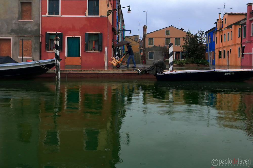 A canal in Burano under some heavy rain in February
