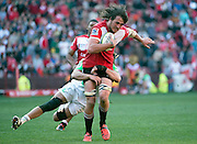 Lions v Highlanders. Franco Mostert of the Emirates Lions is tackled by Dan Pryor of the Highlanders during the 2016 Super Rugby semi-final match at Ellis Park, Johannesburg, 30 July 2016. <br /> <br /> © Anton de Villiers / www.photosport.nz