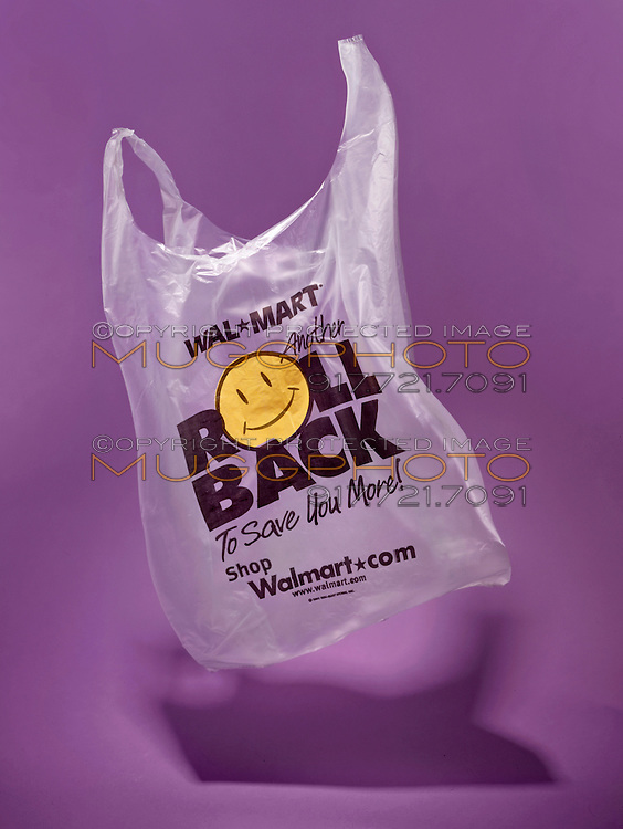 roll back walmart grocery bag floating on a purple background