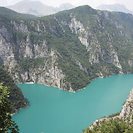 Scutari lake. There are several arguments about the derivation of the name  &quot;Montenegro&quot;, one of these relates to dark and deep forests  that once covered the Dinaric Alps, as it was possible to see them from the sea. <br /> Mostly mountainous with 672180 habitants on an area of 13812 Km&sup2;, with a population density of  48 habitants/Km&sup2;. <br /> It borders with Bosnia, Serbia, Croatia, Kosovo and Albania but  Montenegro has always been alien to the bloody political events that characterized Eastern Europe in recent decades. <br /> From 3 June 2006, breaking away from Serbia, Montenegro became an independent state. <br /> In the balance between economy devoted to sheep farming and a shy tourist, mostly coming from Bosnia and Herzegovina, Montenegro looks to Europe with a largely unspoiled natural beauty. <br /> Several cities in Montenegro, as well as the park Durmitor, considered World Heritage by UNESCO but not yet officially because Montenegro has yet to ratify the World Heritage Convention of UNESCO.