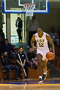 San Francisco Dons forward Chance Anderson (12) pushes the ball down the court against the San Francisco State University Gators at Kezar Pavilion in San Francisco, Calif., on December 6, 2016. (Stan Olszewski/Special to S.F. Examiner)