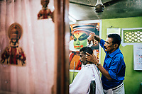 Alleppey, India -- February 20, 2018: A small barbershop in a village on the Keralan backwaters.