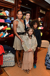 SHERETT DAHLSTROM and her children (L-R) DOMINIQUE DAHLSTROM, SKYE DAHLSTROM and JADEN DAHLSTROM at the 4th birthday party for Amadeus Becker, son of Boris & Lilly Becker held at Ralph Lauren, 143 New Bond Street, London on 9th February 2014.