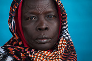 South Sudanese refugee Abok waits to schedule an appointment December 10, 2017 at the UNHCR office reception area in 6th of October city, Egypt.  The scarification on her head and face indicates she is from the Dinka tribe. As of September 2017 there were just over 8,500 refugees registered from South Sudan living in Egypt, making them the 5th largest refugee group in country.