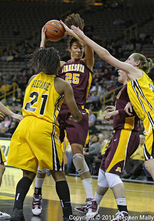 February 10 2011: Minnesota Golden Gophers forward Katie Loberg (25) pulls down a rebound between Iowa Hawkeyes guard Kachine Alexander (21) and Iowa Hawkeyes forward Kelly Krei (20) during the first half of an NCAA women's college basketball game at Carver-Hawkeye Arena in Iowa City, Iowa on February 10, 2011. Iowa defeated Minnesota 64-62.