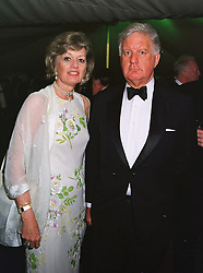SIR PETER & LADY HEAP at a ball in London on 30th June 1999. MTZ 8