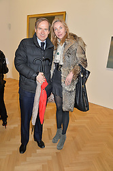 SIMON DE PURY and MICHAELA NEUMEISTER at the opening private view of 'A Strong Sweet Smell of Incense - A portrait of Robert Fraser, held at the Pace Gallery, Burlington Gardens, London on 5th February 2015.