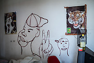 Some of the migrants decorated his room with graffiti