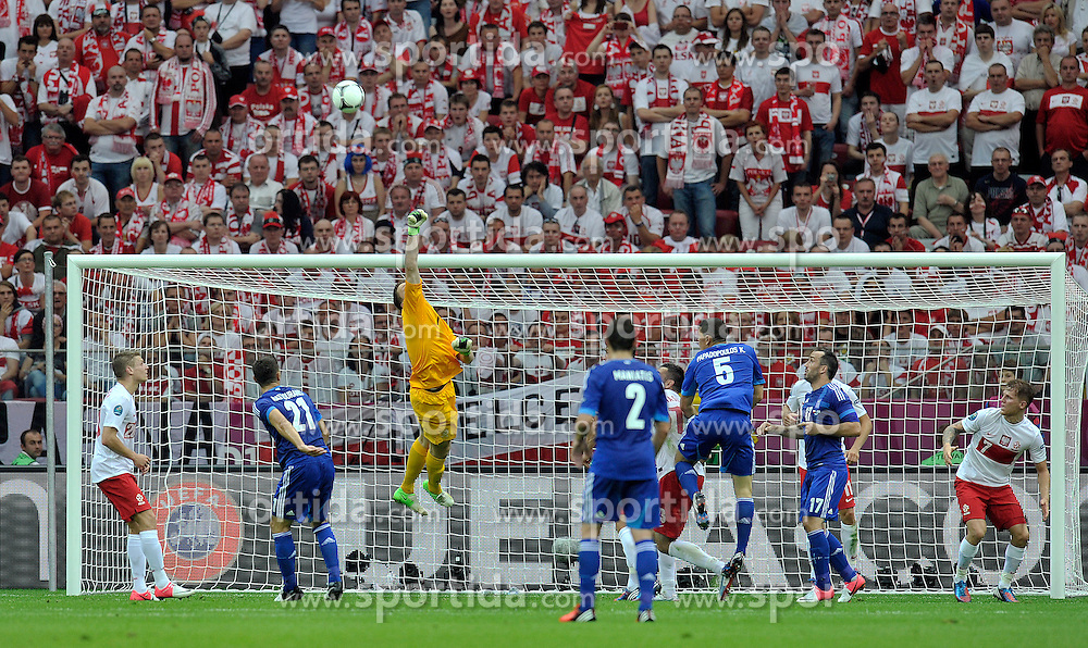(C) Poland's goalkeeper Wojciech Szczesny (nr01) saves during their the UEFA EURO 2012 Group A football match between Poland and Greece at National Stadium in Warsaw on June 08, 2012....Poland, Warsaw, June 08, 2012..Picture also available in RAW (NEF) or TIFF format on special request...For editorial use only. Any commercial or promotional use requires permission...Photo by © Adam Nurkiewicz / Mediasport