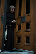 New York, NY, April 2, 2016. Franciscan Brother Paschal DeMattea, O.F.M. opening the door of St. Anthony of Padua Priory in New York City. 04/02/2016. Photo by George Goss/NYCity News Service.