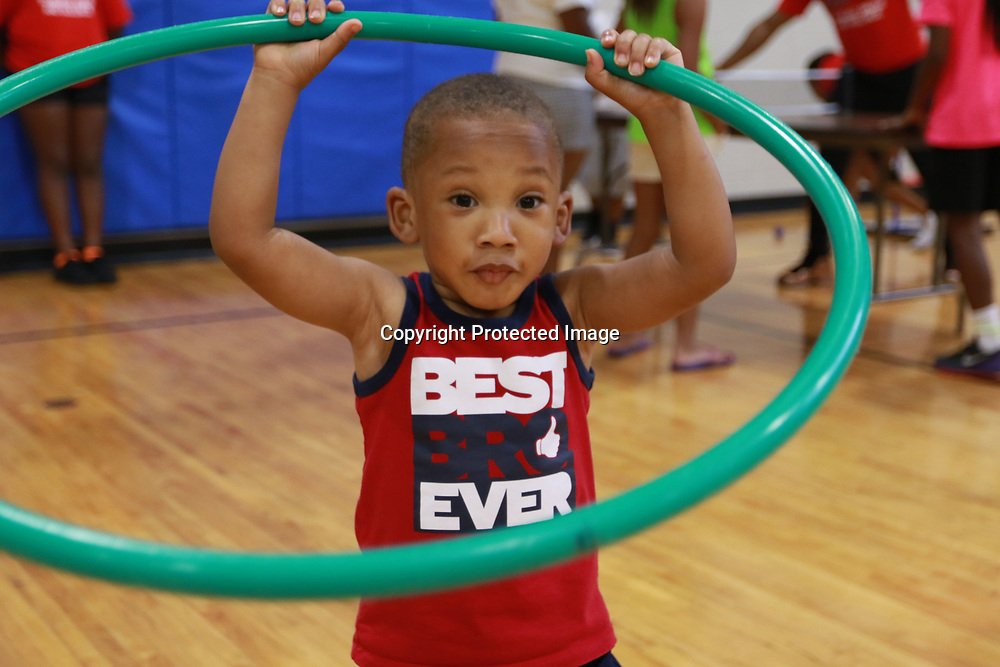 LIBBY EZELL | BUY AT PHOTOS.DJOURNAL.COM<br /> Nolan Dyer, 2 tries his best to hula hoop Saturday at the Police Athletic League building for Police and Kids fun day