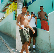 Teenage boys hanging around outside a building Brazil