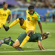 GRENOBLE, FRANCE June 18.  Konya Plummer #5 of Jamaica clears while challenged by Katrina Gorry #19 of Australia during the Jamaica V Australia, Group C match at the FIFA Women's World Cup at Stade des Alpes on June 18th 2019 in Grenoble, France. (Photo by Tim Clayton/Corbis via Getty Images)