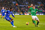 Leicester City midfielder Demarai Gray (7) crosses the ball during the Premier League match between Leicester City and Brighton and Hove Albion at the King Power Stadium, Leicester, England on 26 February 2019.