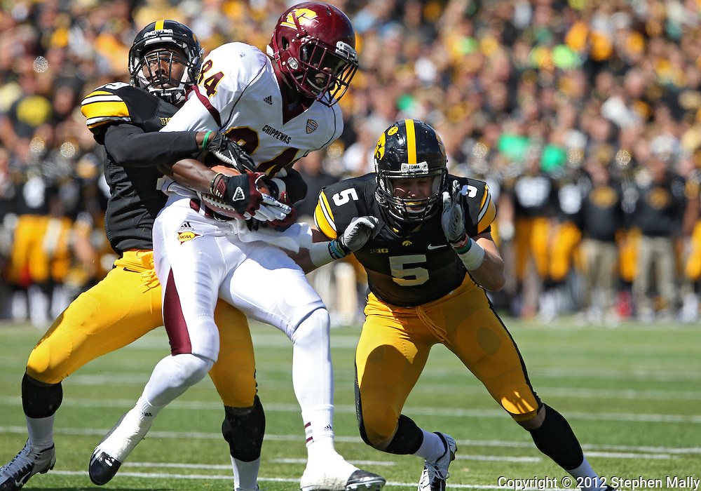 September 22 2012: Central Michigan Chippewas wide receiver Titus Davis (84) is hit by Iowa Hawkeyes defensive back B.J. Lowery (19) and defensive back Tanner Miller (5) after a catch during the second half of the NCAA football game between the Central Michigan Chippewas and the Iowa Hawkeyes at Kinnick Stadium in Iowa City, Iowa on Saturday September 22, 2012. Central Michigan defeated Iowa 32-31.