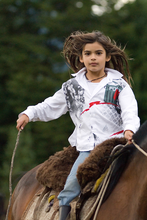 Girl riding a horse in Chile's Futaleufu River Valley.