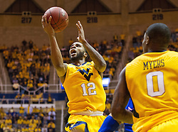 Jan 24, 2017; Morgantown, WV, USA; West Virginia Mountaineers guard Tarik Phillip (12) shoots in the lane during the second half against the Kansas Jayhawks at WVU Coliseum. Mandatory Credit: Ben Queen-USA TODAY Sports