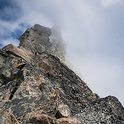 Looking up at the false summit of Forbidden Peak