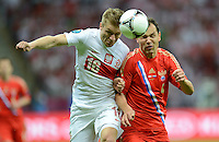 FUSSBALL  EUROPAMEISTERSCHAFT 2012   VORRUNDE Polen - Russland             12.06.2012 Jakub  KUBA Blaszczykowski (li, Polen) gegen Sergei Ignashevich (re, Russland)