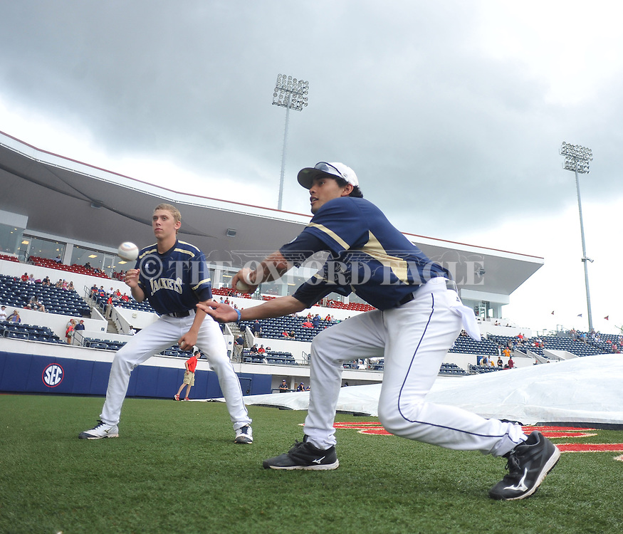 Georgia Tech's Elliott Brazilli (16) and Georgia Tech's Ben Parr (23) wait out a rain delay before the game against Washington at the NCAA Oxford Regional at Oxford-University Stadium on Friday, May 30, 2014. (AP Photo/Oxford Eagle, Bruce Newman)