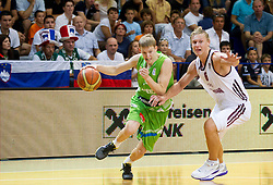 Miha Lapornik of Slovenia vs Janis Timma of Latvia during basketball match between National teams of Latvia and Slovenia in Qualifying Round of U20 Men European Championship Slovenia 2012, on July 16, 2012 in Domzale, Slovenia. Slovenia defeated Latvia 69-62. (Photo by Vid Ponikvar / Sportida.com)