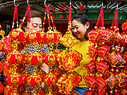 11 JANUARY 2019 - BANGKOK, THAILAND: Women shop for Chinese New Year decorations at a street stall in Bangkok's Chinatown. About 14% of Thais are of Chinese ancestory and Lunar New Year is widely celebrated in Thailand. Chinese New Year celebrations in Bangkok start on February 4, 2019. The coming year will be the Year of the Pig in the Chinese zodiac.      PHOTO BY JACK KURTZ