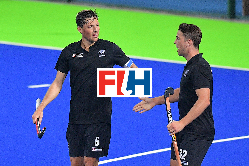 New Zealand's Simon Child (L) celebrates scoring a goal with Nick Wilson during the men's field hockey New Zealand vs Brazil match of the Rio 2016 Olympics Games at the Olympic Hockey Centre in Rio de Janeiro on August, 10 2016. / AFP / Carl DE SOUZA        (Photo credit should read CARL DE SOUZA/AFP/Getty Images)