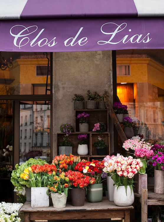 A flower shop displays its wares in the Latin Quarter (Quartier latin)  in Paris.