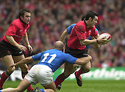 27/03/2004  -  RBS Six Nations Championship 2004 Wales v iItaly.Wales Stephen Jones attacking.   [Mandatory Credit, Peter Spurier/ Intersport Images].