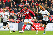 Middlesbrough forward Britt Assombalonga (9) plays the ball with Fulham forward Bobby Decordova-Reid (14) and Fulham midfielder Harrison Reed (21) in close attendance during the EFL Sky Bet Championship match between Middlesbrough and Fulham at the Riverside Stadium, Middlesbrough, England on 26 October 2019.