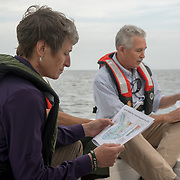 FLORIDA CITY, FLORIDA - APRIL 22, 2016<br /> Sally Jewell, United States Secretary of the Interior, holds a printed breakdown of the areas affected while riding on  U.S. Parks Service boat in the waters of the Everglades National Park while looking at dying sea grass in the waters of the park. On the right is Robert Johnson, South Florida Natural Resources Center director.<br /> (Photo by Angel Valentin)