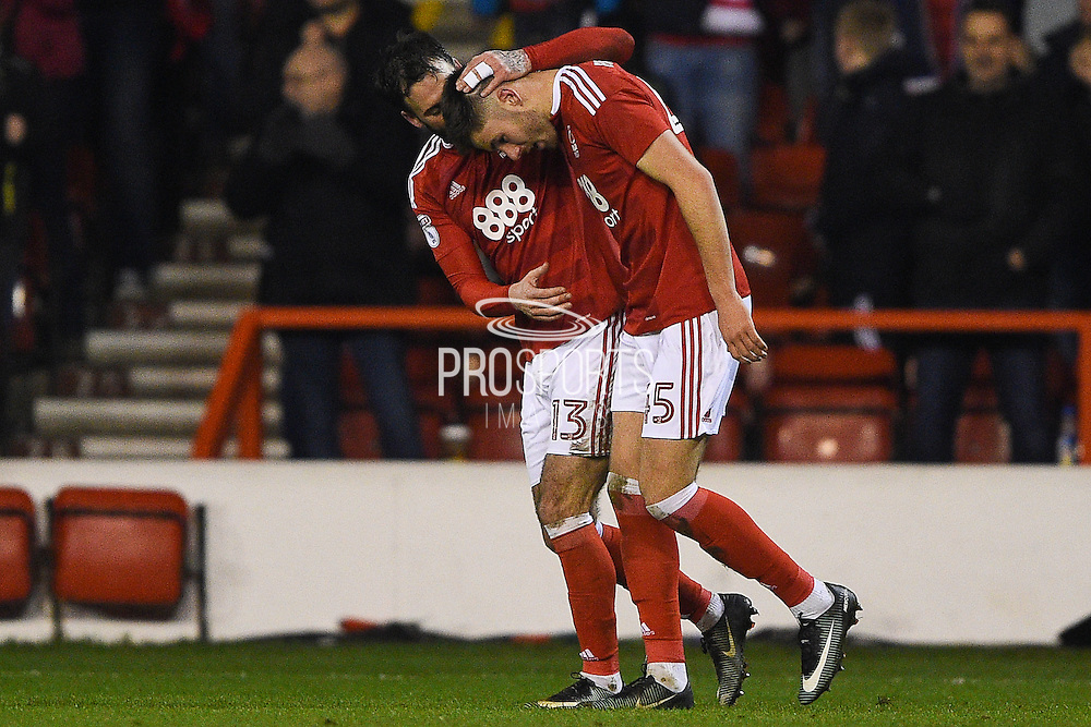 Nottingham Forest defender Danny Fox (13) and Nottingham Forest forward Ben Brereton (45) celebrate after scoring a goal to make it 2-1 during the EFL Sky Bet Championship match between Nottingham Forest and Aston Villa at the City Ground, Nottingham, England on 4 February 2017. Photo by Jon Hobley.