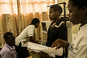 Nurses take vital information of Elina Mukagasigwa and Innocent Nsabimana during a screening for Rheumatic heart disease at the University Teaching Hospital of Kigali in Rwanda.<br /> <br /> Rheumatic heart disease is damage to one or more heart valves that stems from inadequately treated strep throat. Left untreated, rheumatic heart disease leads to heart failure.