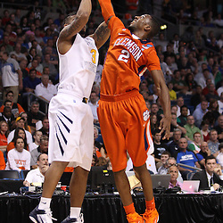 Mar 17, 2011; Tampa, FL, USA; Clemson Tigers guard Demontez Stitt (2) blocks a shot by West Virginia Mountaineers guard Casey Mitchell (3) during the second half of the second round of the 2011 NCAA men's basketball tournament at the St. Pete Times Forum. West Virginia defeated Clemson 84-76.  Mandatory Credit: Derick E. Hingle