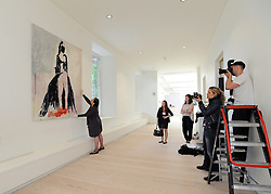 "© under license to London News Pictures. LONDON, UK  05/05/2011. Members of the press photograph the tapestry 'The Black Cat' by Tracy Emin which took seven years to complete.  The unveiling today (5 May 2011) of Tracey Emin's first tapestry ahead of the launch of COLLECT, the Crafts Council's international craft fair for contemporary objects at the Saatchi Gallery, London. Tracy Emin say's: ""The Black Cat is one of my favourite paintings. It took me seven years to complete...""Photo credit should read Stephen Simpson/LNP."