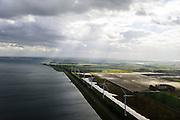 Nederland, Zuid-Holland, Goeree-Overflakkee, 23-10-2013; Haringvliet, foto richting Stad aan 't Haringvliet, windturbines aan de dijk.<br /> Windmills on the dyke long the Haringvliet.<br /> luchtfoto (toeslag op standaard tarieven);<br /> aerial photo (additional fee required);<br /> copyright foto/photo Siebe Swart.