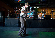 Robert McGeorge  dances as Tim Zach and the Whiskey Bent Band performs Thursday evening during the Hall County Fair at the Barn Bar at Fonner Park in Grand Island. Whiskey Bent is the first in a series of local acts performing at the fair this year. (Independent/Matt Dixon)