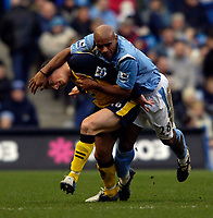 Photo: Jed Wee.<br />Manchester City v Wigan Athletic. The Barclays Premiership. 18/03/2006.<br /><br />Manchester City's Trevor Sinclair (R) climbs all over Wigan's Leighton Baines.