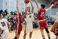 Laconia's Kelby Brooker and Jakob Steele keep pressure on Belmont's Matt Thurber during NHIAA Division III Basketball Tuesday evening.  (Karen Bobotas/for the Laconia Daily Sun)