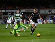 20th September 2017, Dens Park, Dundee, Scotland; Scottish League Cup Quarter-final, Dundee v Celtic; Celtic goalkeeper Craig Gordon beats Dundee's A-Jay Leitch-Smith in a race for the ball
