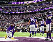 Minnesota Vikings wide receiver Laquon Treadwell (11) and Minnesota Vikings running back Jerick McKinnon (21) celebrate McKinnon's touchdown during a game against the Green Bay Packers on Sunday at U.S. Bank Stadium in Minneapolis. (Matt Gade / Republic)