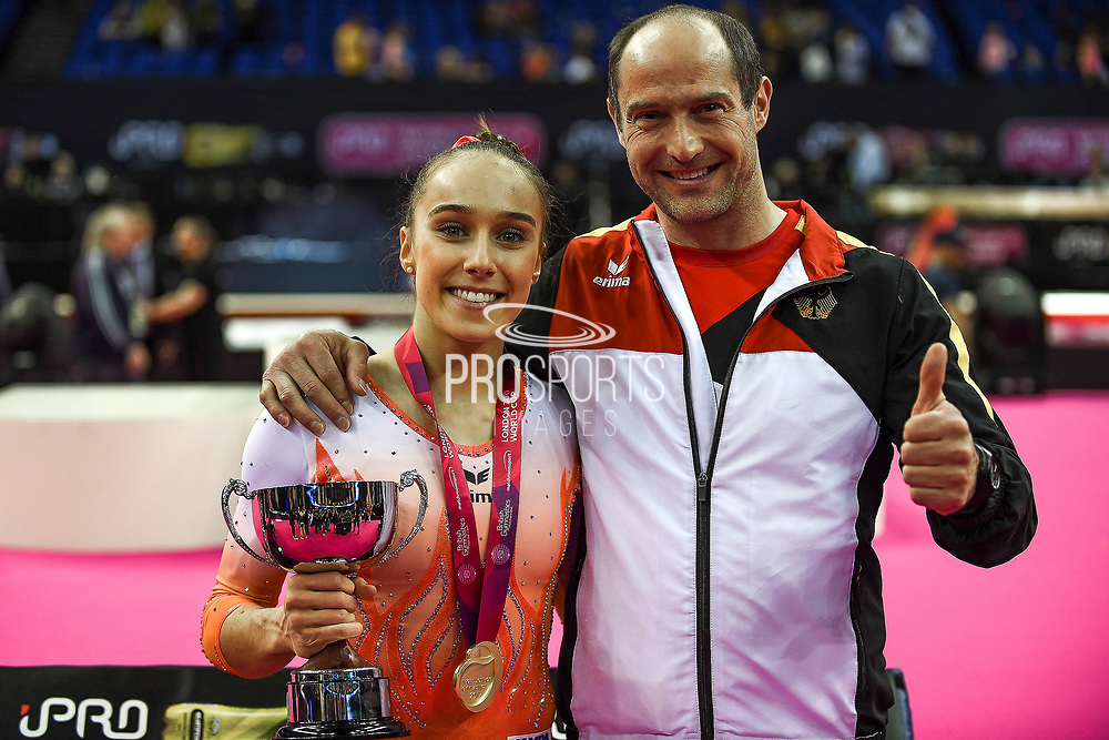 Tabea Alt of Germany (GER) wins the women's gold medal with her coach during the iPro Sport World Cup of Gymnastics 2017 at the O2 Arena, London, United Kingdom on 8 April 2017. Photo by Martin Cole.