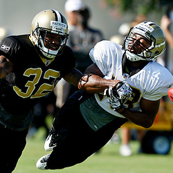 July 31, 2011; Metairie, LA, USA; New Orleans Saints rookie cornerback Johnny Patrick (32) knocks the ball away from rookie wide receiver Michael Galatas (18)during training camp practice at the New Orleans Saints practice facility. Mandatory Credit: Derick E. Hingle
